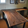 A custom native edge wood desk by the author. 