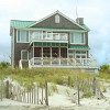 Photo of a beach house with a screened in porch by lightbulbf/sxc.hu.