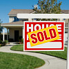 Photo of a house with a sold sign by Feverpitched/istockphoto.com.