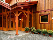 Photo of a house with wood board-and-batten vertical siding by laughingmango/istockphoto.com.