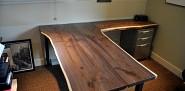A custom native edge wood desk by the author.