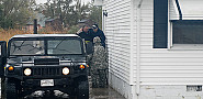 The MD National Guard evacuates a resident. (Photo: The National Guard/Flickr)