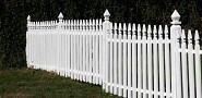 Photo of white picket fence by thadz/sxc.hu.