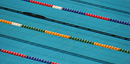Photo of an Olympic size swimming pool by dtcreations/morguefile.com.