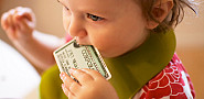 Photo of cute baby and credit card by _Dinkel_/Flickr.
