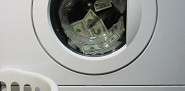 Conceptual photo of a washing machine and money by foobean01/sxc.hu.