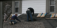 Photo of roofers installing asphalt shingles by waitscm/Flickr Creative Commons.