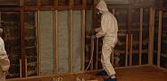A worker sprays foam insulation. (ilovebutter/Flickr)