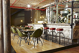 This coffee shop features a number of reclaimed timber elements. Photo/design: Haldane Martin/Flickr
