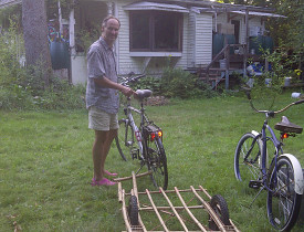 Gabor Lukacs with his DIY bamboo bike trailer. Photo by Cris Carl.