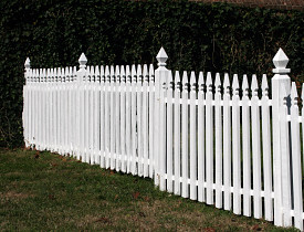 Photo of white picket fence by thadz/sxc.hu.