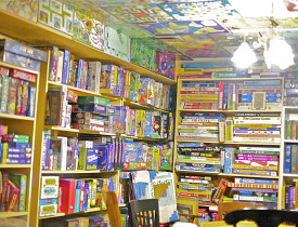 Photo of totally impressive game closet by Sayward Rebhal.