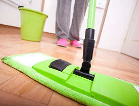 A soft dust mop and a little water are all you need to clean a hardwood floor. (Photo: LukaTDB/istockphoto.com)