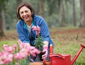 Photo of a mom gardening by kali9/istockphoto.com.
