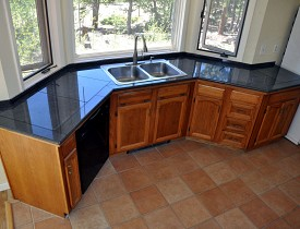 Granite tile counter top and photo by KMS Woodworks.