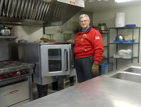 Dick Henry in the Guiding Star Grange's new kitchen. Photo by Cris Carl.