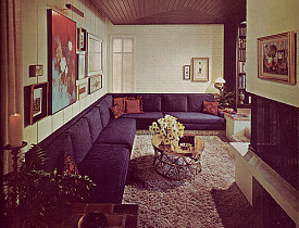 A cool retro living room with painted brick walls and a painted brick fireplace surround. Photo: army.arch/Flickr Creative Commons