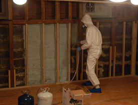A worker sprays foam insulation. (ilovebutter/Flickr)