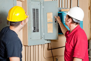 electricians at electrical panel