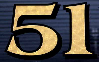 This house number is not hand gilded. It is 23.5K gold on vinyl. Photo and number by The House Number Lab.