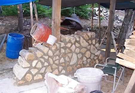 Cordwood masonry in progress.  Photo: Todd Muller.