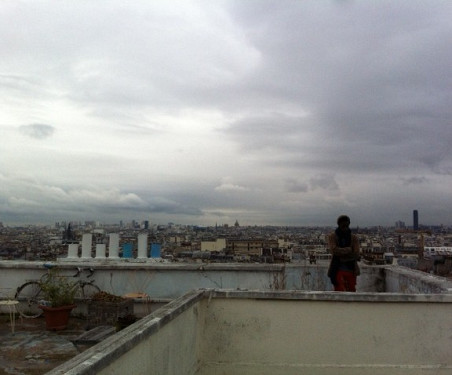 Williams looking out over Paris from his roof