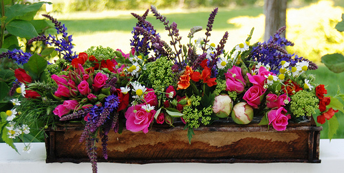 A DIY floral centerpiece like this makes a beautiful Mother's Day gift. Photo by hello-julie/Flickr Creative Commons.