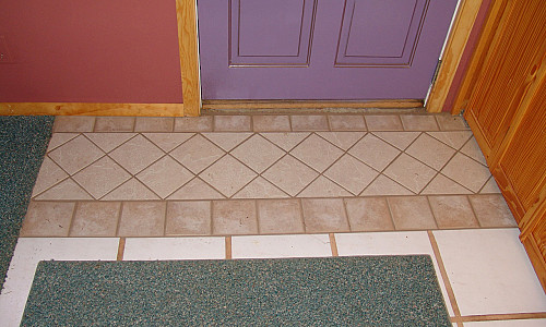 Tile repair work by Kevin Stevens of KMS Woodworks.
