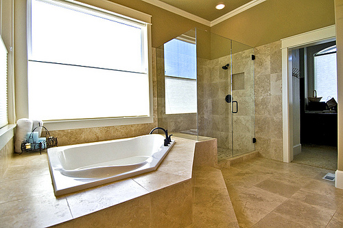 I love this travertine tile bathroom. Sitka Projects LLC/Flickr Creative Commons.