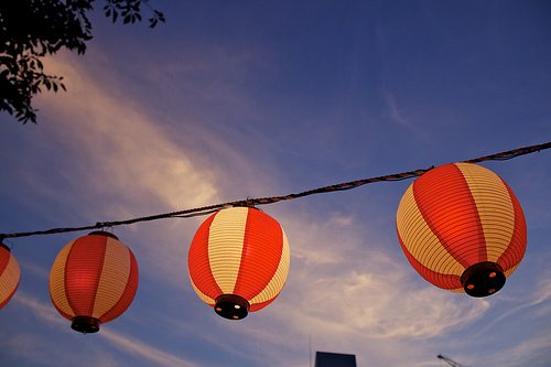 Plug outdoor lights, like strings of lanterns, into GFI outlets. Photo: seafaringwoman/Flickr.