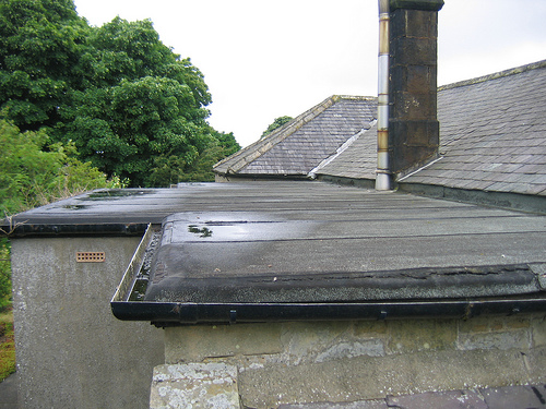 Photo of a leaky flat roof by  Bryn Pinzgauer/Flickr.