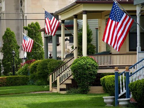 Flags fly appropriately on staffs. Photo by summersetretrievers/istockphoto.com