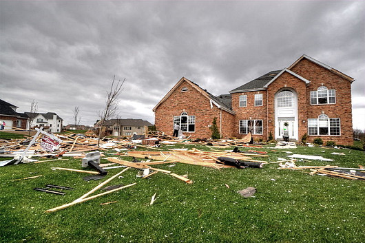 Missing shingles on the roof of a house where a tornado passed by. (Photo: Robert Lawton/Wikimedia Commons)