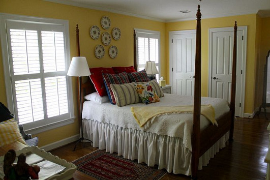 old fashioned bedroom yellow walls and antique