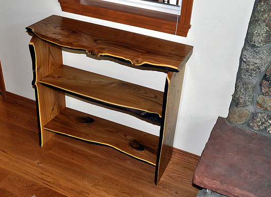 A native edge wood book case made by the author.