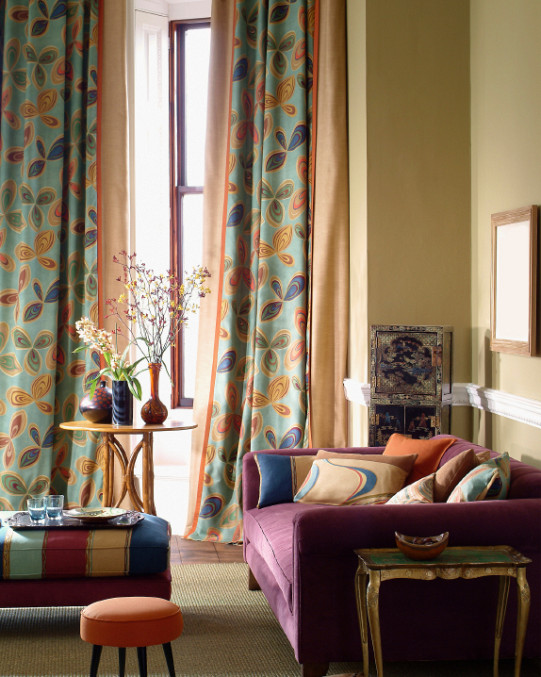 A bright three seater sofa defines this colorful living room space. (Photo: istockphoto.com)